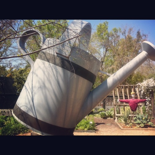 Giant watering can sculpture at Longue Vue Gardens