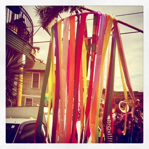A Krewe of St. Anne flag in front of Mimi's in the Marigny