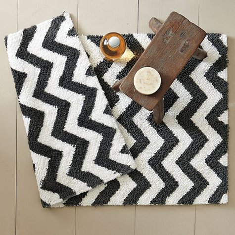 This bath mat would be fun with the gray striped shower curtain above 24  right here. Striped Bath Rugs