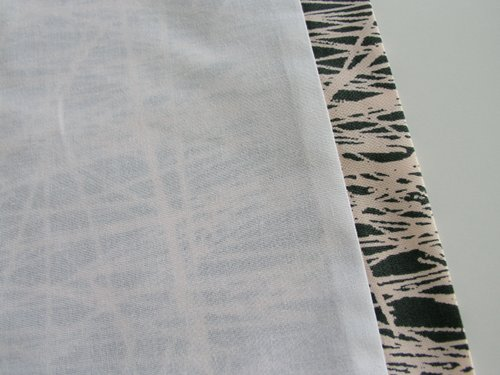 This process makes the exterior fabric wrap around to the lining side so that if the edges of your curtain panels flip out slightly, you'll see your ...