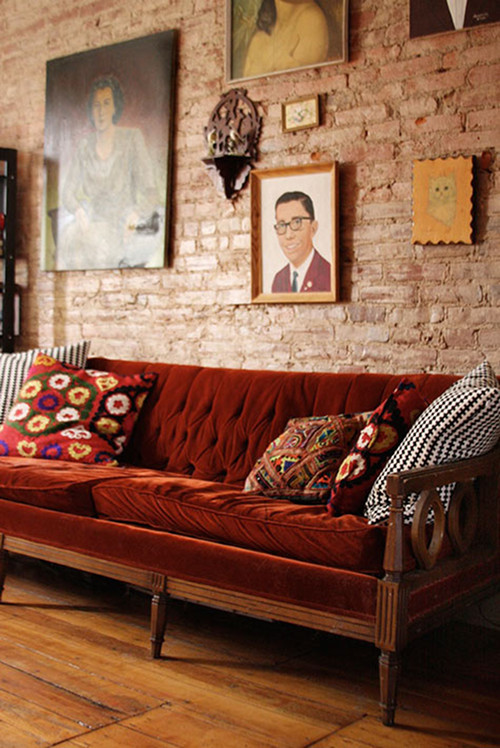 Image Above: Lizzy Janssen Displays Her Collection Of Vintage Hand Painted  Portraits Above The Sofa In Her Philadelphia Home.