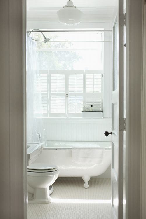 Image above: This bathroom, with its salvaged clawfoot tub ...