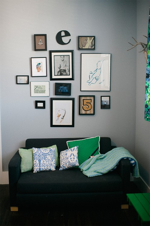 Design Sponge / This photo exemplifies living with young boys, pillows are rarely perfect as this couch doubles as wrestling mat most days.  The wall includes a watercolor sketch I made of Eames Ever at 4 months old.  The throw is a handmade gift from my Aunt.  The paint color for bedrooms is Sherwin Williams Intellectual Gray.