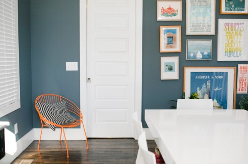 Design Sponge / The dining room greets front door guests with lots of original prints, since Nashville has such a rich history. Original prints are from Tugboat Printshop, artist Carl Pope and Hatch Show Print.  The iceberg painting is one of mine. Walls are Sherwin Williams Web Gray.