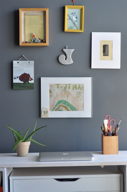 """Design Sponge / This is my desk for small or administrative projects.  Several of the paintings are my paternal grandmother's.  I framed her """"recipe"""" for mixing color behind some of her watercolor tubes."""