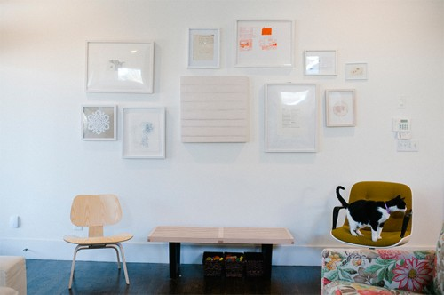 Design Sponge / The wall opposite our fireplace is quiet, mostly framed line drawings to balance the heft of the floral couch, including a spare painting from a trade with Johanna Winter Harper, a Chicago-based artist and friend.