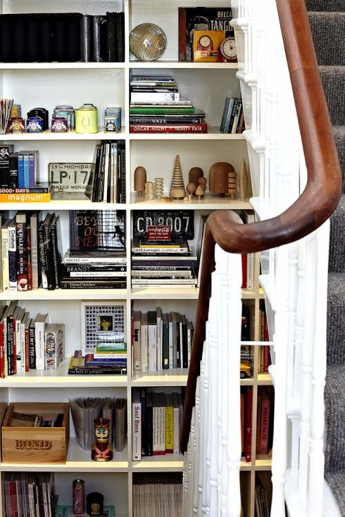Design*Sponge Sneak Peek We have three landings, each with a blank wall on them, so we built bookcases on each to house all of our books and random objects. What's nice is that it feels like one really tall set of shelves going through the floors.