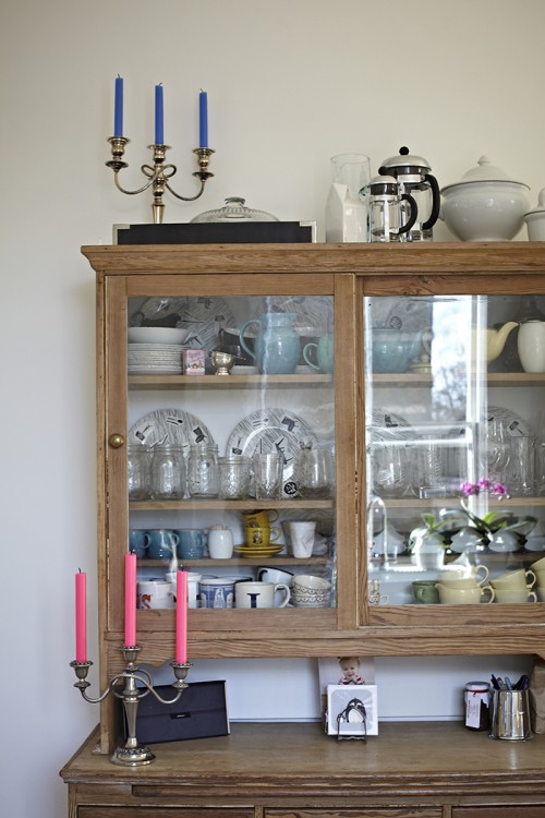 """Design*Sponge Sneak Peek This dresser was a find in Hastings – filled with my collection of """"Homemaker"""" china – and it has a great little surface that pulls out of the center section."""