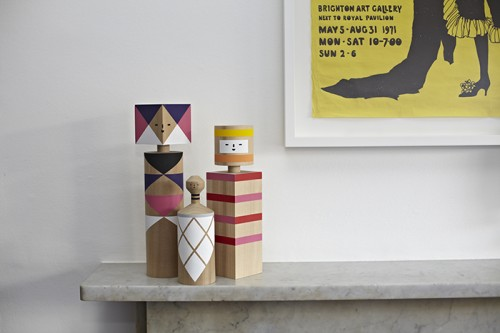 """Design*Sponge Sneak Peek These 'Kokeshi' figures are by our very talented friend Mark Giglio, who lives in Oakland, California. We just bought some more of his work – """"Forest of Woods,"""" a 15-piece set, seen on the bookcase."""
