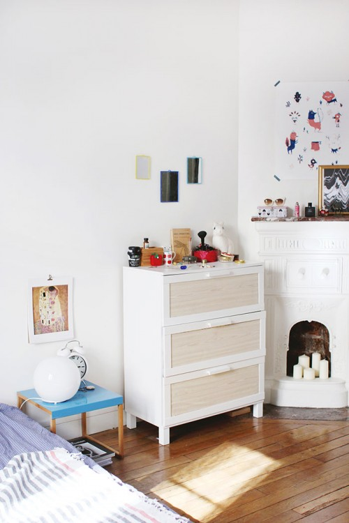 Design Sponge/ The customized chest of drawers are from Ikea. The poster on the wall is by Lucille Michieli.