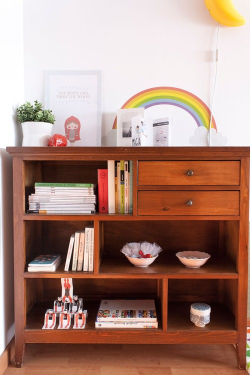 """Design Sponge/ I use my grandparent's shelf to store some of my work (including my little red ridinghood poster), and some books and magazines on graphic design, photography and illustration. It also has my little collection of notebooks and diaries (I love all Pony Brown products!), and special bookmarks: the """"Fernandos"""" a paper circus show made by illustrator, Marc Sardà."""