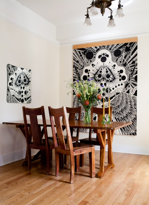 Design Sponge/ Nathan makes intricate images using ink on industrial felt. This is one of his large pieces. The table and chairs belongs to our roommate, Josh Gold.