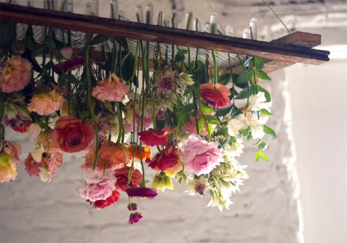 Diy project hanging floral chandelier designsponge hanging floral arrangements are everywhere right now and they are a really beautiful way to show off flowers they are perfect for events such as a bridal aloadofball Image collections
