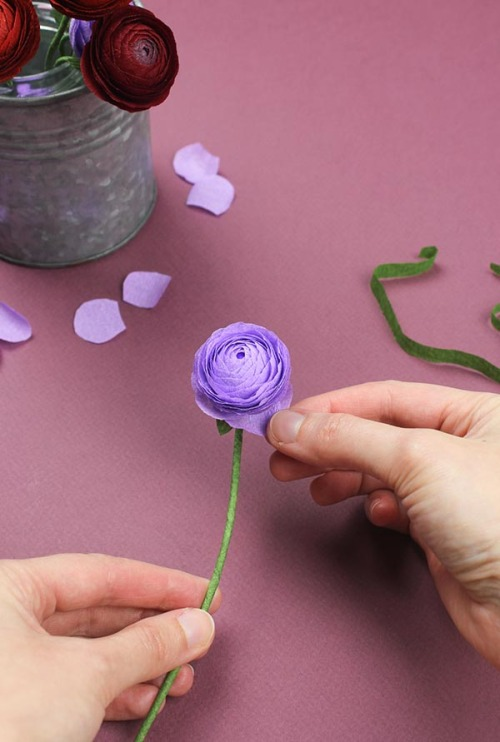 Diy project paper ranunculus designsponge now you have your finished flower and you can style it as you wish by shaping the stem and also gently bringing down a few of the lower petals of the mightylinksfo