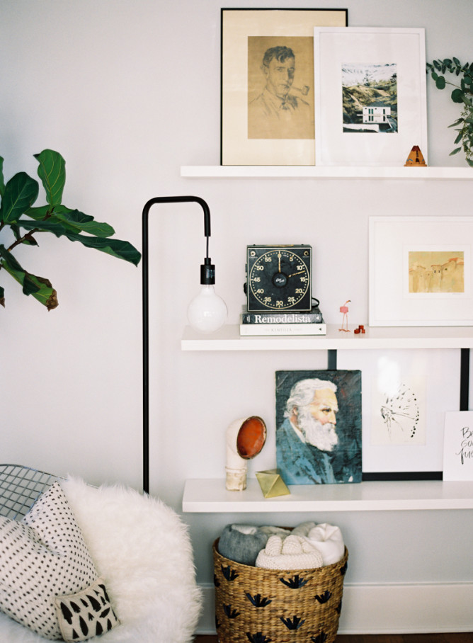 Caroline's father built this bookcase for them. They've mixed vintage pieces and art with modern ones. It's styled without being overdone, too busy or too sparse.