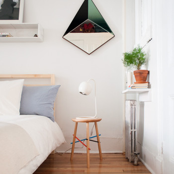 Jeffrey's side of the bed. Pyramid mirror and stool by Bower. Rug by Joinery.