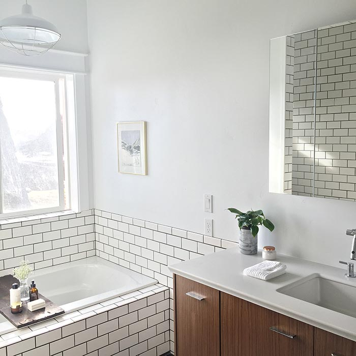 modern subway tile bathroom before amp after a modern bathroom for a 1905 farmhouse 19622