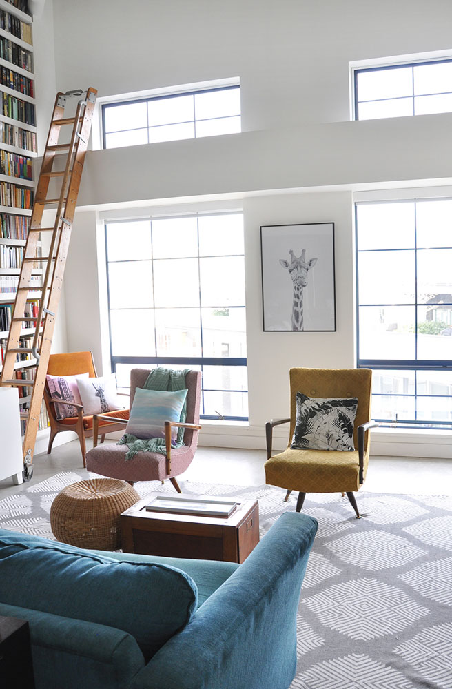 Nicole and Andrew's  loft floods with natural light from giant windows and skylights. The clean lines of the loft mix perfectly with the eclectic personality of their pieces.