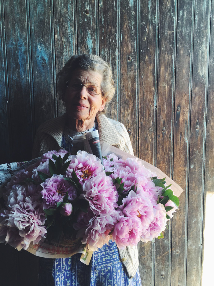Madame Loichet with her fresh garden flowers
