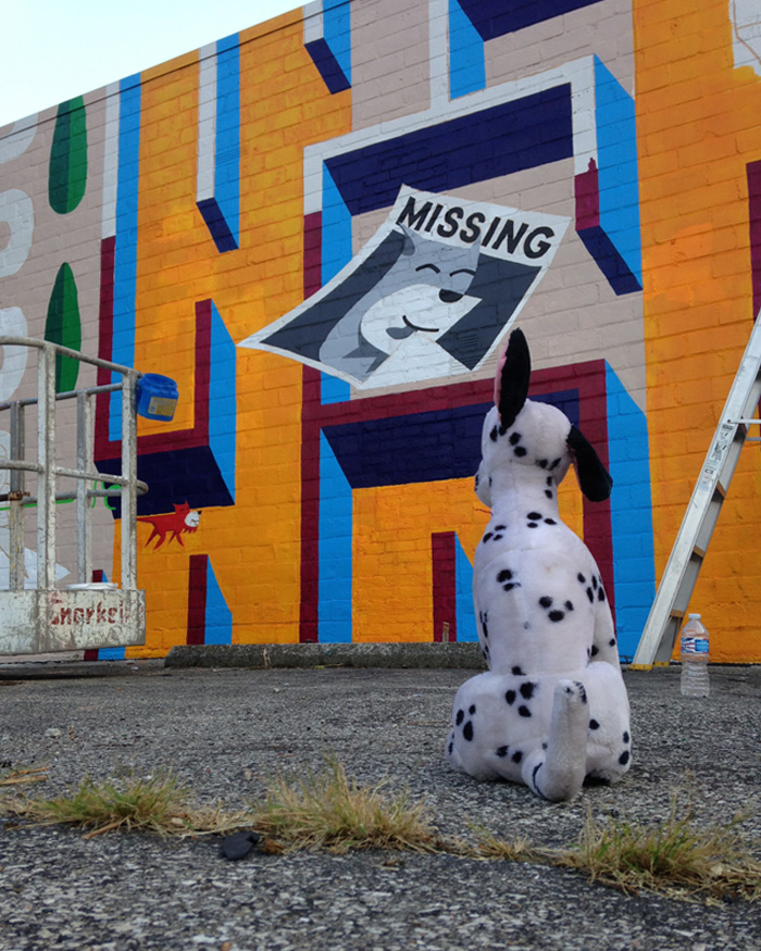 An abandoned neighborhood stuffed animal admires the Amazewall progress which is located adjacent the Love Wall and is among the citys most intricate murals.