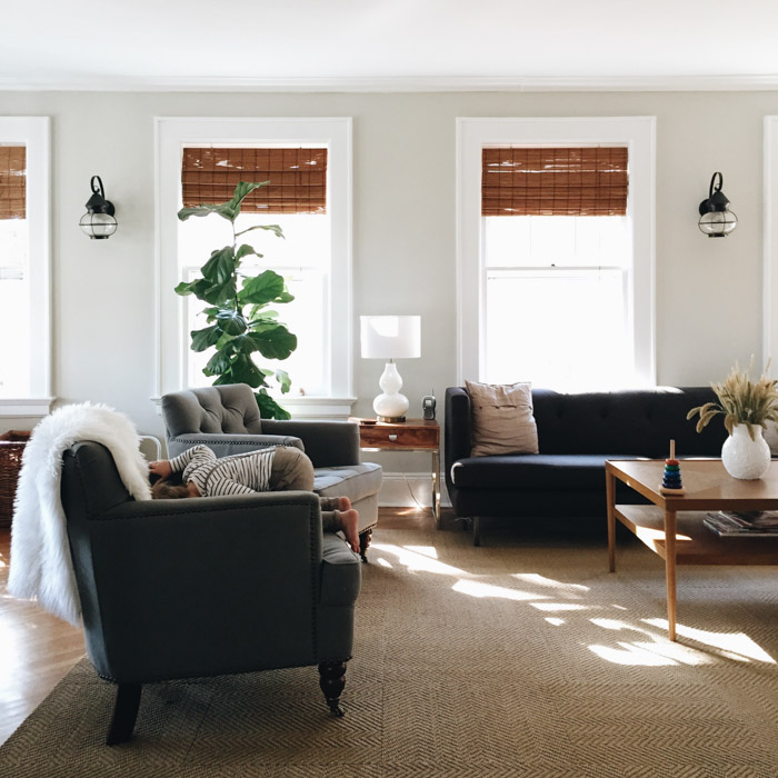 For Sarah, her family comes first, and the living room becomes the space they all love to hang out in. While tickets and art aren't realistic with two young boys running around, Sarah's beloved fiddle leaf fig that she purchased online two years ago is prominently displayed, adding a nice pop of color to the space.