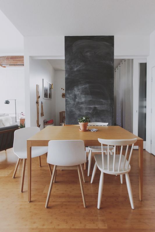 The table was found on Craigslist (originally from Design Within Reach) and the molded chairs are from HAY Design. The family painted the small section of wall that separates Theo's bedroom and the bathroom with black chalkboard paint.