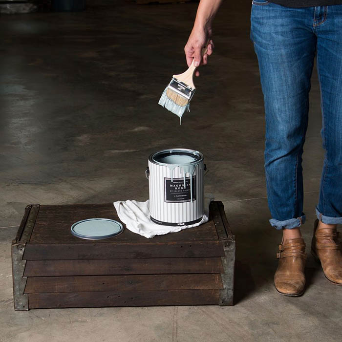 Joanna Gaines With Magnolia Home Paint Can