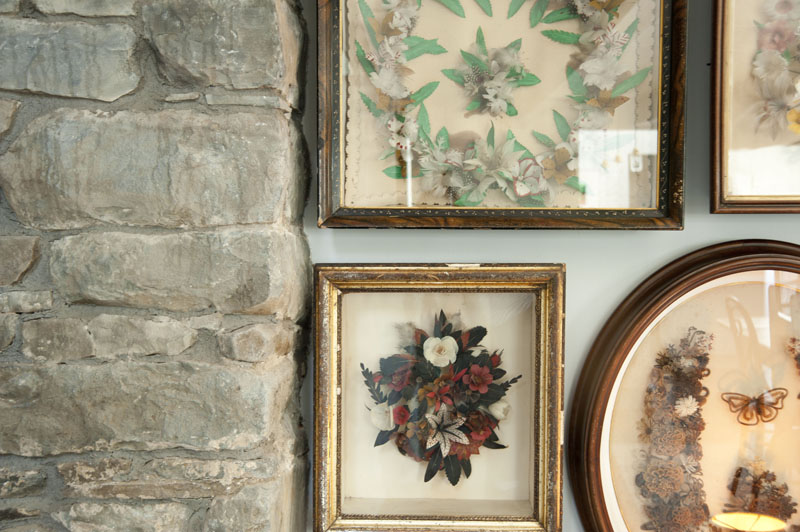 design*sponge home tour Philip Leeming and Leong Ong, stone wall, antique Victorian hair and floral artwork, dining room