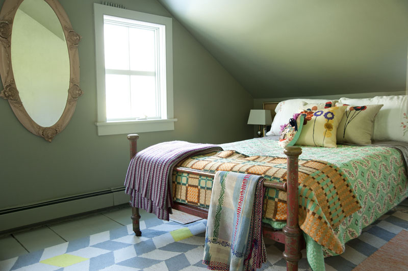 design*sponge home tour Philip Leeming and Leong Ong, bedroom, guest bedroom, textiles, comforter, floral pillows, mirror