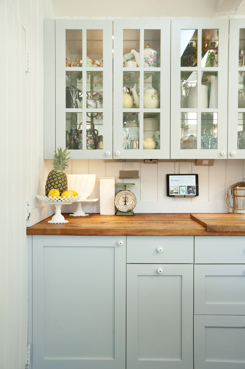 design*sponge home tour Philip Leeming and Leong Ong, kitchen, kitchen cupboards, vintage dishes,milk glass
