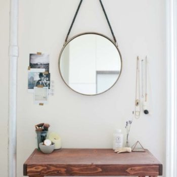 If you have open wall space and a mirror, you have the opportunity to create a design moment or functional zone. Since Kristen Cesiro didn't have enough space to get ready for the day in her tiny Brooklyn bathroom, she designated this area in the bedroom as a vanity. An Anthropologie mirror pulls the whole space together.