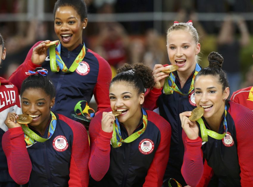 2016 Rio Olympics - Artistic Gymnastics - Final - Women's Team Victory Ceremony - Rio Olympic Arena - Rio de Janeiro, Brazil - 09/08/2016. Simone Biles (USA) of USA (L), Gabrielle Douglas (USA) of USA (Gabby Douglas) (top L), Laurie Hernandez (USA) of USA (C), Madison Kocian (USA) of USA (top R), Alexandra Raisman (USA) of USA (Aly Raisman) (R) pose with their gold medals on the podium after winning the women's team final. REUTERS/Mike Blake TPX IMAGES OF THE DAY. FOR EDITORIAL USE ONLY. NOT FOR SALE FOR MARKETING OR ADVERTISING CAMPAIGNS.
