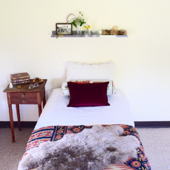 My guest room with five easy pieces from Crate and Barrel: Metal Shelf, Brenner Beet Red Velvet Pillow, Tall Bud Vase, Teeny Bud Vase, and Sheepskin Throw in Taupe.