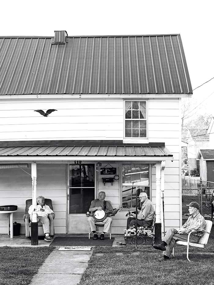 Men on a porch photograph by Johnny Autry from Victuals cookbook by Ronni Lundy on DesignSponge