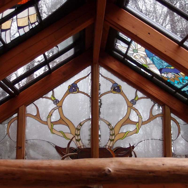 Cruelty-Free Antlers In This Stained Glass Cabin On Design*Sponge