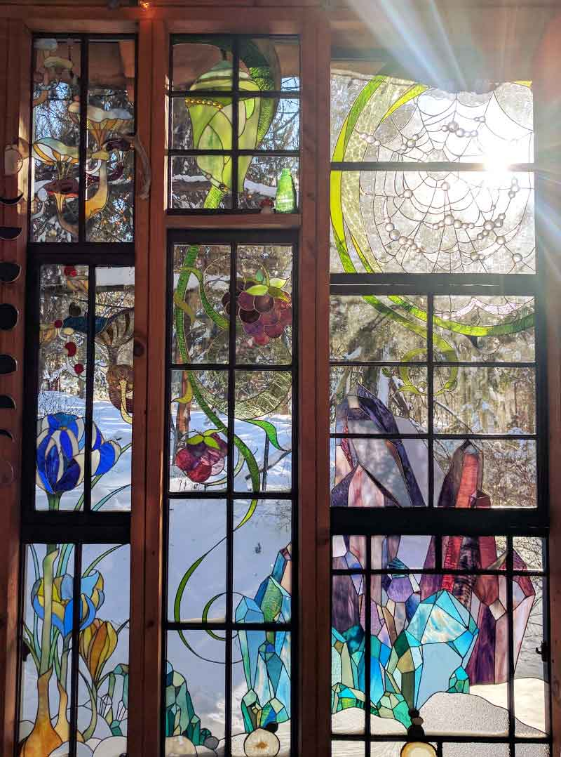An Impressive Wall Of Stained Glass In Neile Cooper's Glass Cabin On Design*Sponge