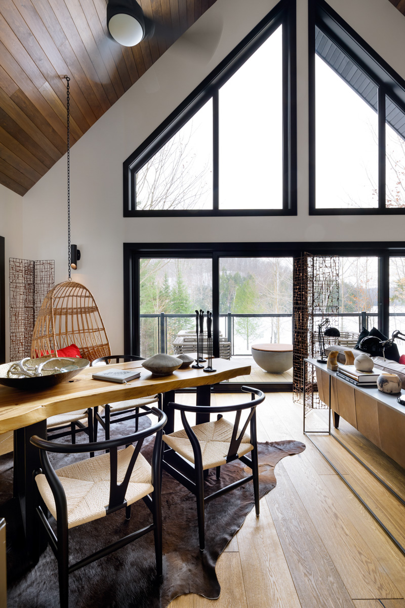 Image Above Colin And Justin S Cabin Contrasts Modern Black Almost Floor To Ceiling Windows With Traditional Country Vibes The Framing Highlights