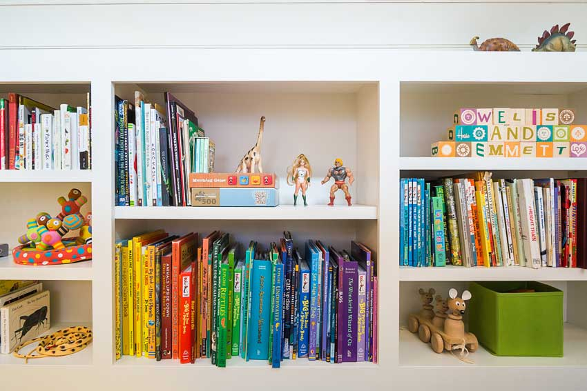 A Kids Bookshelf Upstairs Displays Toys And Books In This Converted Carriage House On Design*Sponge