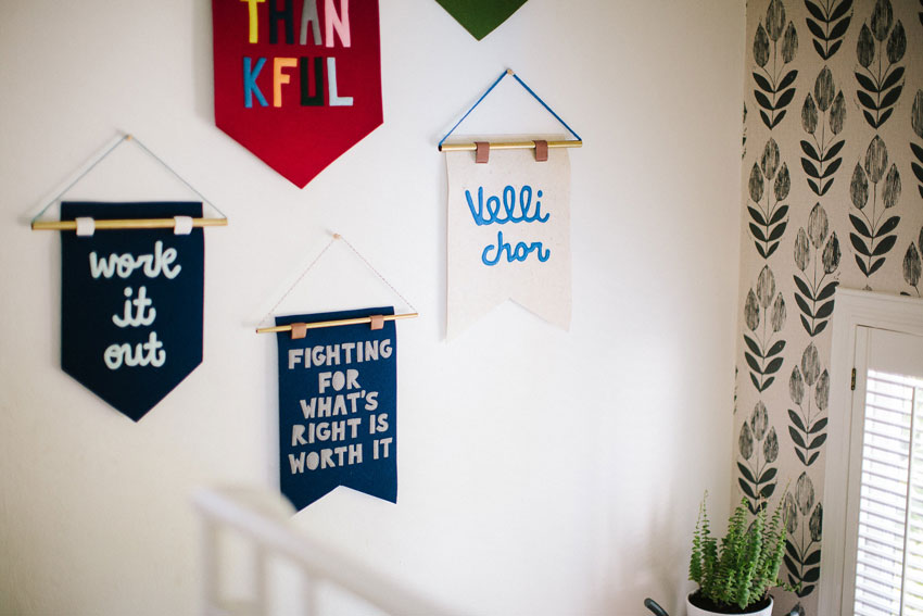 Diana's Company Makes The Banners Hanging Above Their Stairs On Design*Sponge