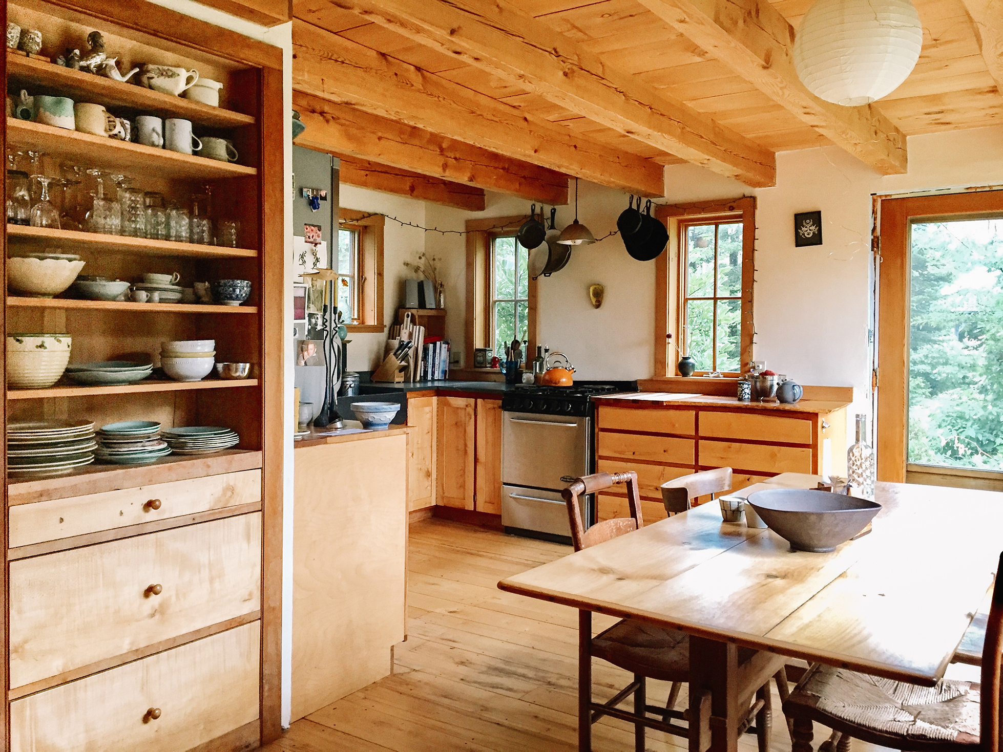 A vermont cabin built by hand to house a family s history for Kitchen cabinets vermont