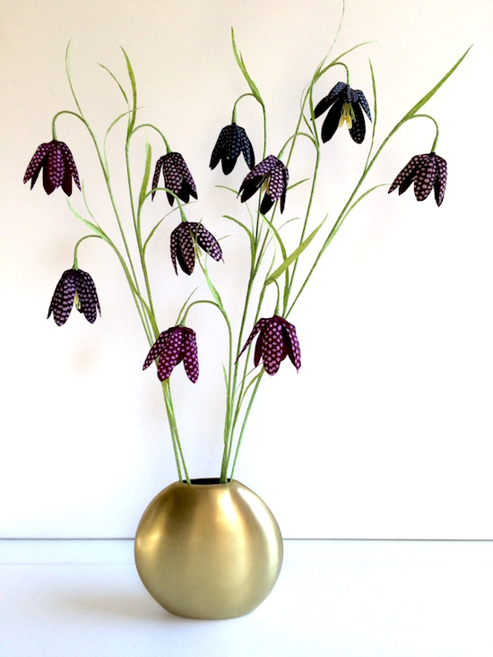 gold vase filled with fritillaria stems