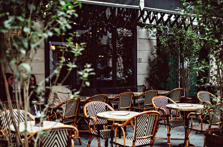 Classic Parisian Cafe Furniture Adorn The Outside Dining Area On Design*Sponge