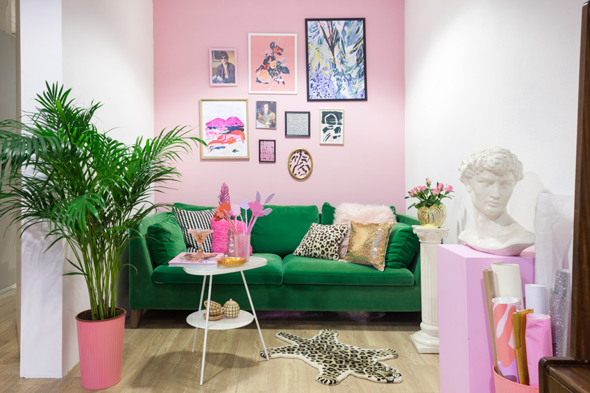 A Bold Emerald Green Couch Juxtaposed Against A Pale Pink Wall In The French Toast Studio On Design*Sponge