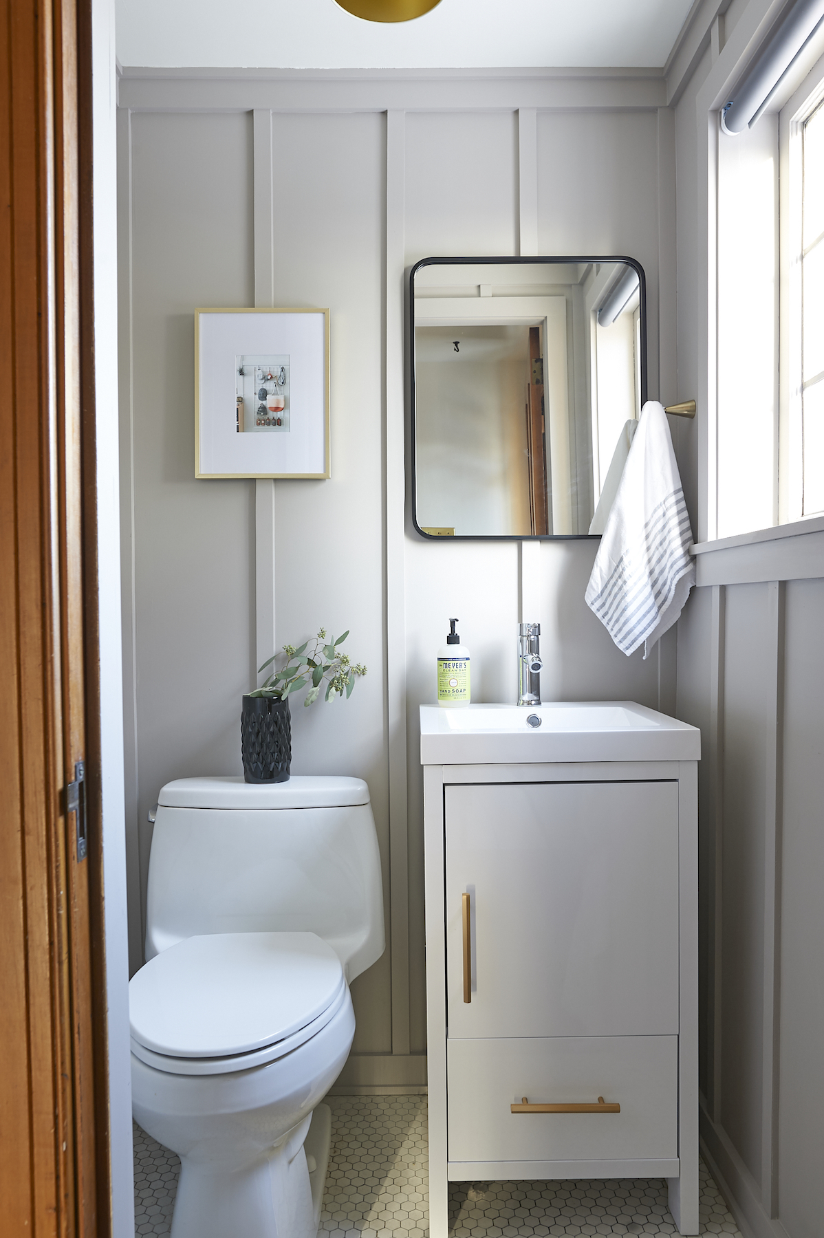 BEHR Park Avenue paint color on board and batten paneled walls of a coastal bathroom - Design Sponge. #parkavenue #behrparkavenue #paintcolors #mushroompaintcolor