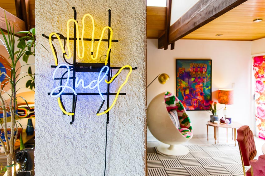 A Vintage Neon Sign Welcoming You To The Dining Room In This New Zealand Home On Design*Sponge