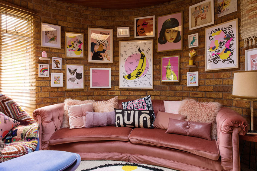 A Round Room With Curved Couch And Gallery Wall On Design*Sponge