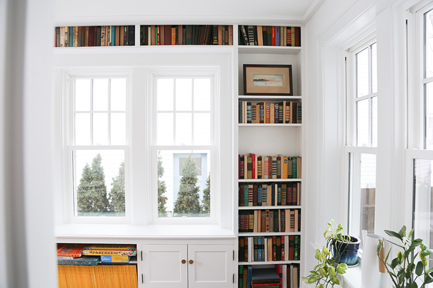 Built-In Bookshelves Frame The Windows In This Michigan Home Library On Design*Sponge