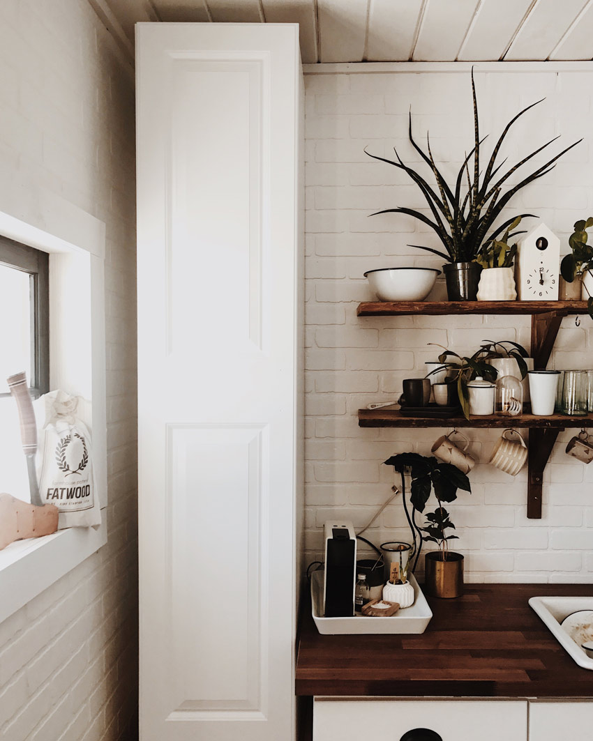 A Narrow Shelf In The Kitchen Area Adds Much Needed Storage Tour The Tiny Cabin On Design*Sponge