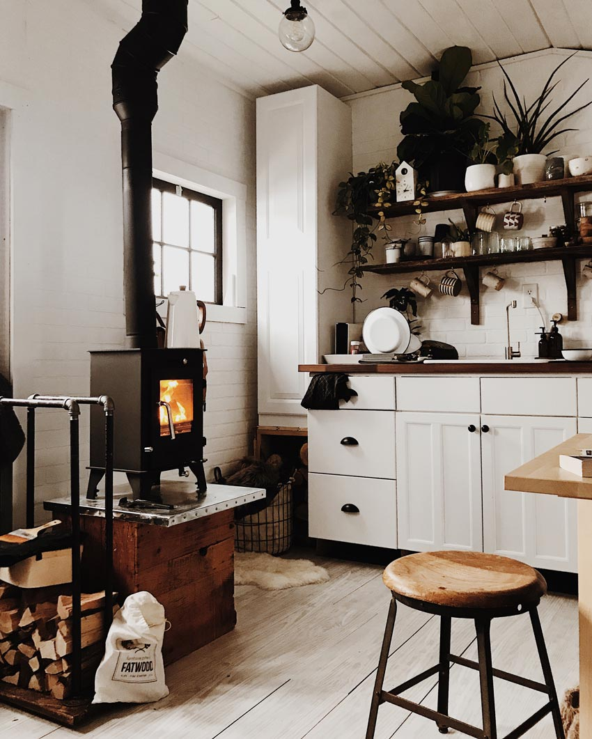 A Tiny House With A Tiny Wood Stove On Design*Sponge
