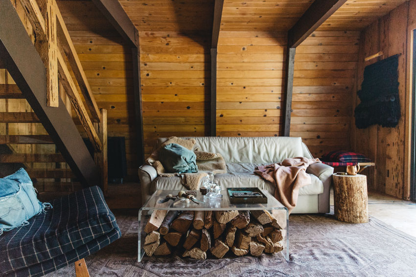 A Ghost Coffee Table Stores Extra Logs For The Fire In This Big Bear Cabin Tour On Design*Sponge